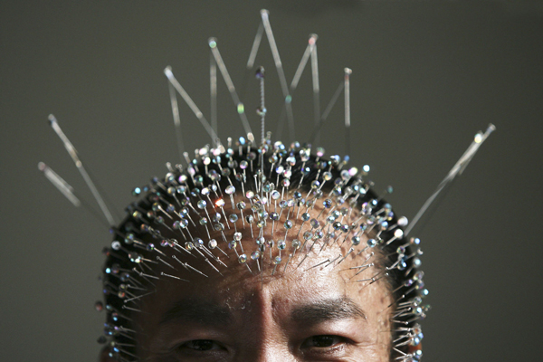 Chinese Guinness World Record Holder Inserts 1,200 Needles Into Head