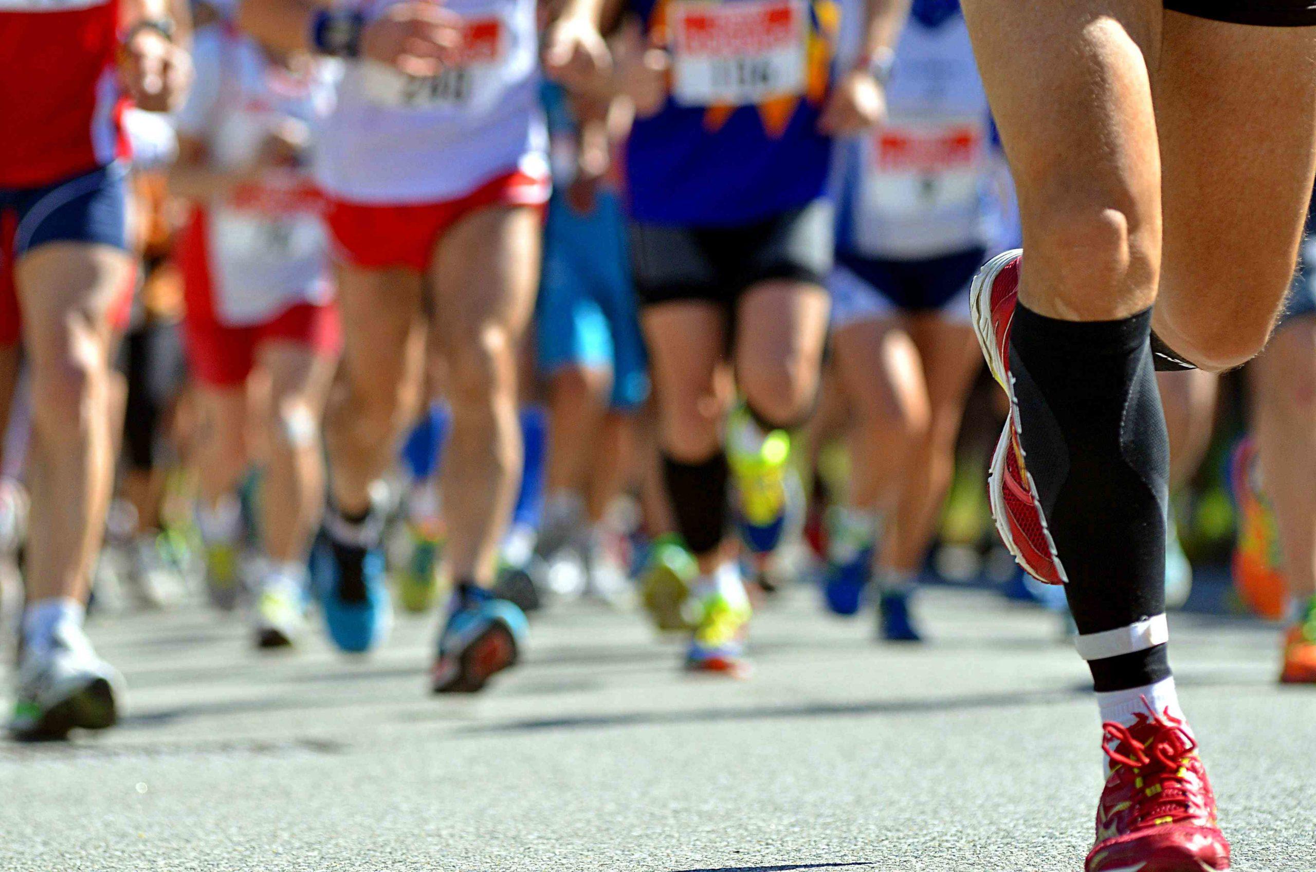 low-section-of-people-running-on-street-in-marathon-691137951-fe6503aa02724ef392d189da26adb339